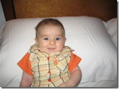 infant smiling on pillow