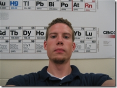selfie in front of the periodic table of elements