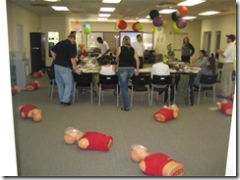 cpr dummies spread out on the floor in classroom