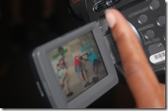 student using camcorder