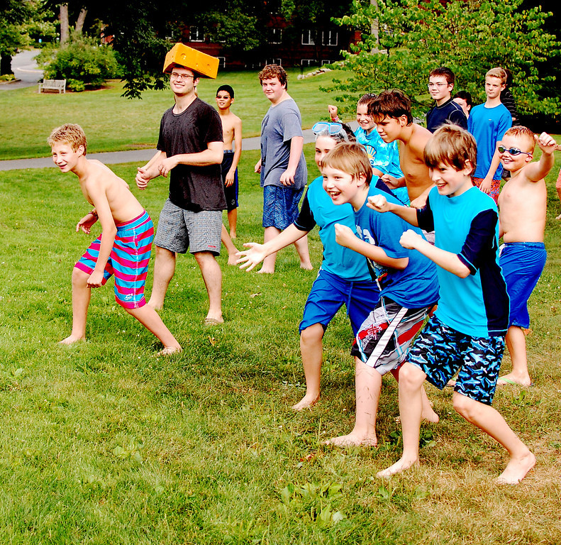 students outside at tech camp playing water games