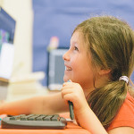 girl learning coding in front of computer