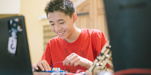 boy assembling project circuit board